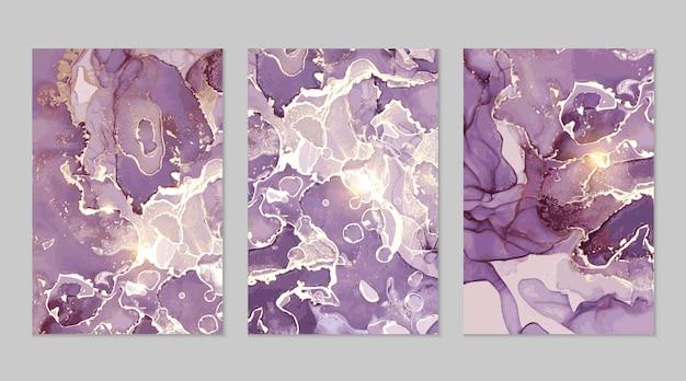Luxe paarse en gouden marmeren abstracte achtergronden in alcoholinkttechniek.