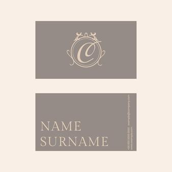 Luxe visitekaartjesjabloon in goud- en grijstint met flatlay voor- en achteraanzicht