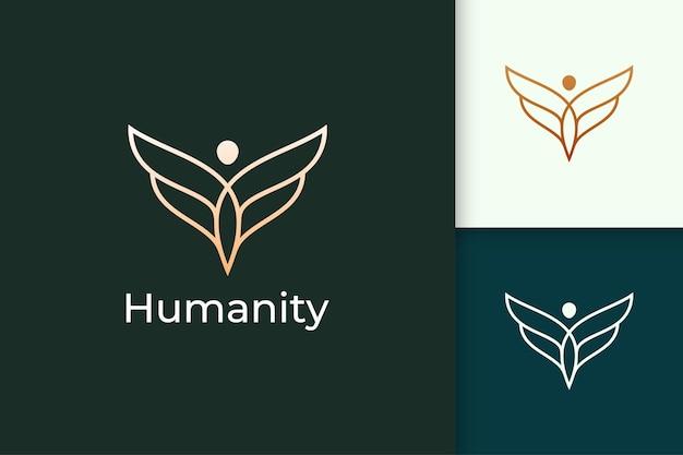 Luxe vrijheidslogo in mens en vleugel vertegenwoordigen de mensheid of vrede