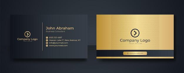 Luxe zwarte visitekaartje ontwerpsjabloon met gouden art deco geometrische lijnen.