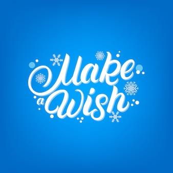 Maak een wens met de hand geschreven letters met vallende sneeuw en sneeuwvlokken.