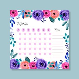 Maandelijkse planner met kleurrijke aquarel bloemen