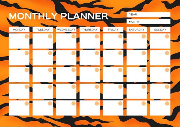 Maandplanner. leuke pagina voor notities. notitieboekjes, stickers, agenda, schoolaccessoires. tijger bont. wild dier stijl. grote kat. ruimte voor tekst. wit oranje zwart.