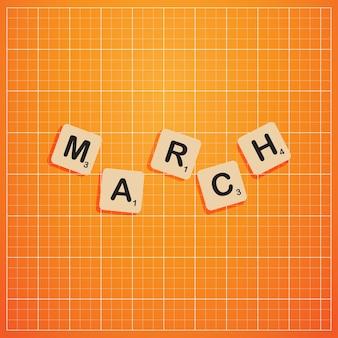 Maart maand in hoofdletters met scabbles blok concept