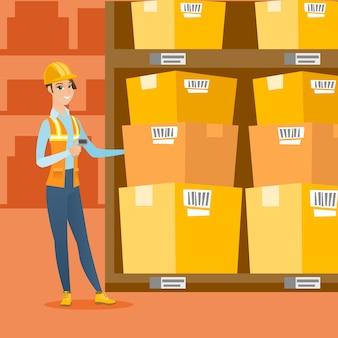 Magazijnmedewerker scannen van streepjescode op doos.