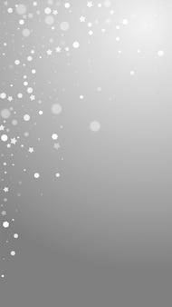 Magische sterren willekeurige kerstachtergrond. subtiele vliegende sneeuwvlokken en sterren op grijze achtergrond. levend winter zilveren sneeuwvlok overlay sjabloon. levendige verticale illustratie.