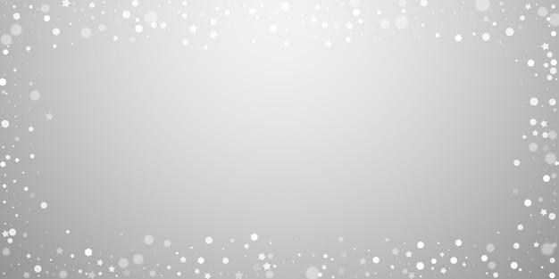Magische sterren willekeurige kerstachtergrond. subtiele vliegende sneeuwvlokken en sterren op lichtgrijze achtergrond. geweldige winter zilveren sneeuwvlok overlay sjabloon. opmerkelijke vectorillustratie.