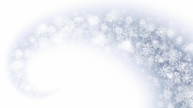 Magische wervelende sneeuwvlokken en lichtoverlay op lichtblauwe achtergrond