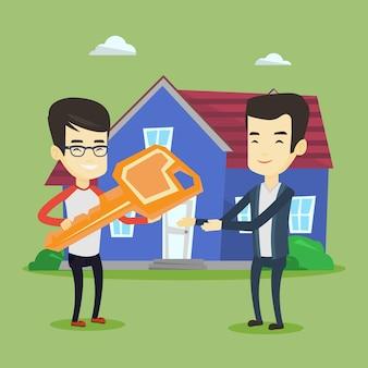 Makelaar in onroerend goed die sleutel geeft aan nieuwe huiseigenaar.