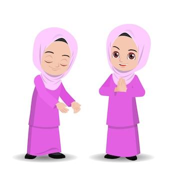 Maleis meisje in hijab groet selamat hari raya