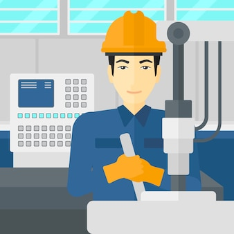 Man aan het werk met industriële apparatuur.