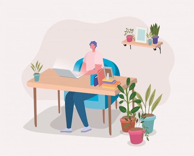 Man aan het werk met laptop op bureau