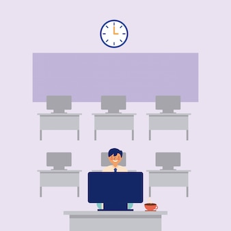 Man aan het werk op bureaublad op klas