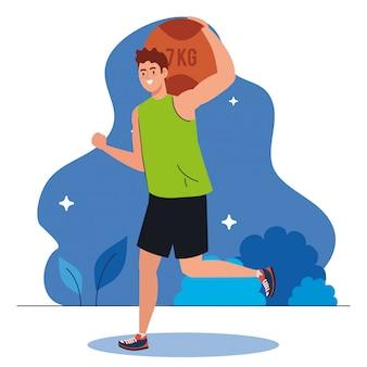Man beoefenen van oefening met bal van zeven kilogram buiten, recreatie sport
