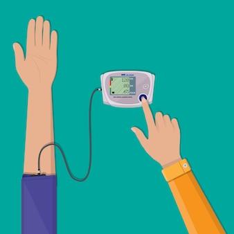 Man controleert hoge bloeddruk op monometer