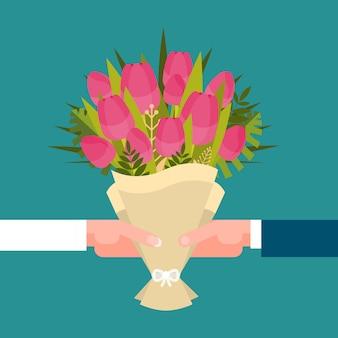 Man en meisjeshanden die boeket van concept van de vrouwen van tulpen het gelukkige internationale dag houden