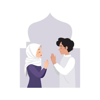 Man en vrouw begroeten elkaar en vieren eid mubarak