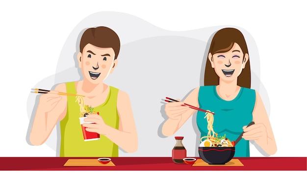 Man en vrouw die noedels eten, mensen die voedsel eten