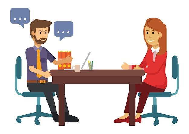 Man en vrouw die over zaken in koffie spreken