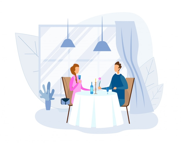 Man en vrouw die romantisch diner hebben bij restaurant