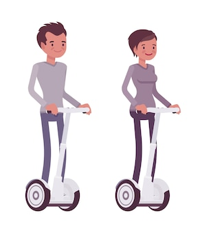 Man en vrouw die witte elektrische autopedden berijden