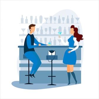 Man en vrouw drinken en praten bij toog