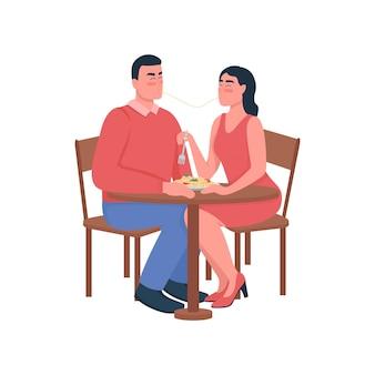 Man en vrouw eten spaghetti plat