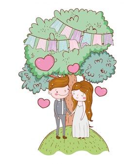 Man en vrouw met partijvlaggen en harten