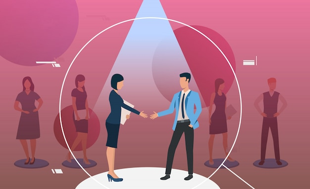 Man en vrouw staan in de schijnwerpers en handshaking