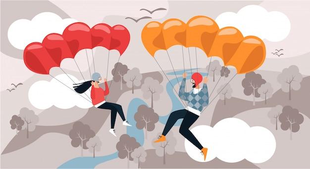 Man en vrouw vliegen naar beneden met parachute