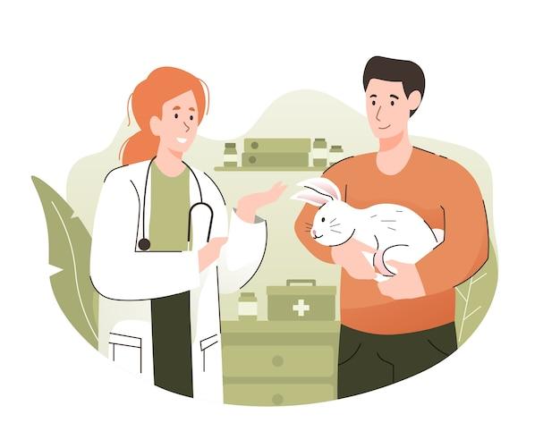 Man en zijn konijn bespreken met een dierenarts bij veterinaire kliniek