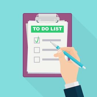 Man hand met pen en doelen opschrijven om te bereiken in notitieblok