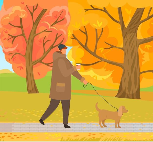 Man hond wandelen in herfst bos park in de herfst