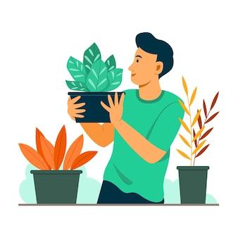 Man houdt een pot met plant in de tuin
