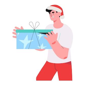 Man in een kerstman hoed houdt geschenkdoos