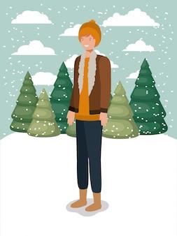 Man in snowscape met winterkleren