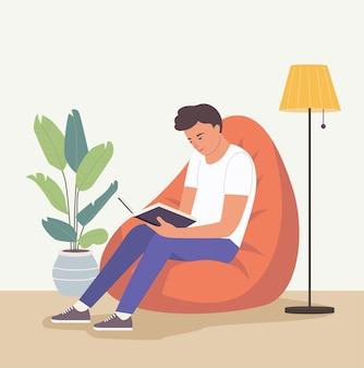 Man is ontspannen op comfortabele zitzak stoel en leesboek