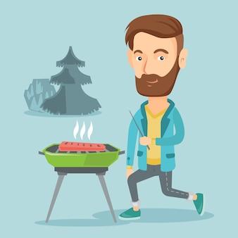 Man koken steak op barbecue grill.