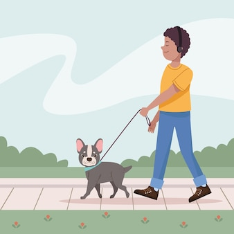 Man loopt met franse bulldog