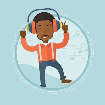 Man luisteren naar muziek in hoofdtelefoons en dansen