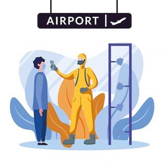 Man met beschermend pak man temperatuur controleren op de luchthaven