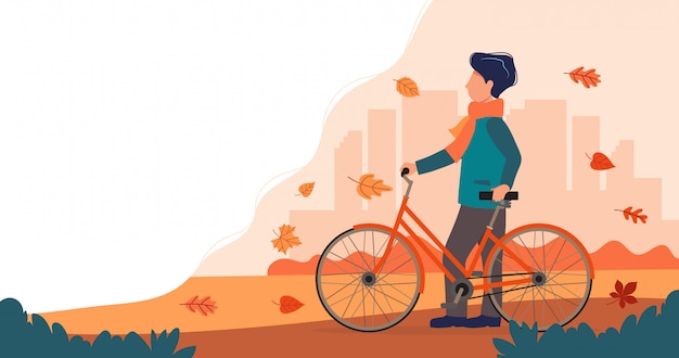 Man met een fiets in de herfst.