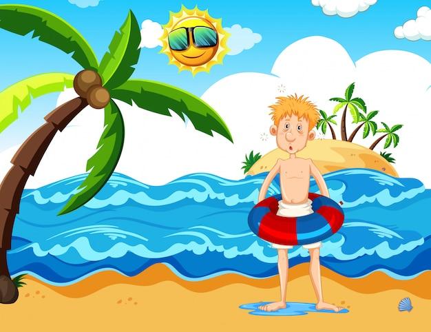 Man met een floaty op het strand