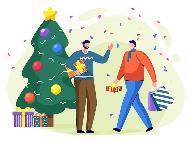 Man met huidige vak in de buurt van de kerstboom