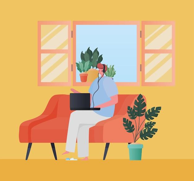 Man met laptop bezig met oranje bankontwerp van het thema werk vanuit huis
