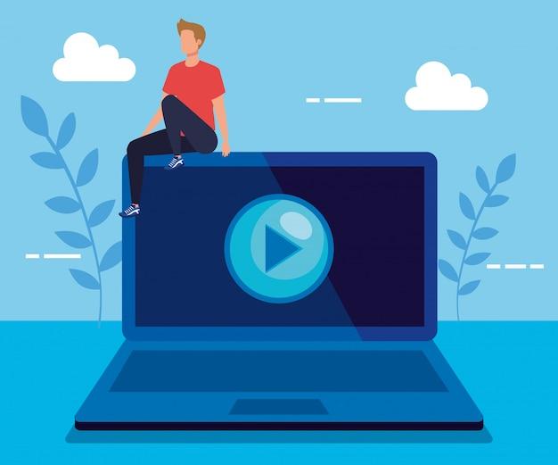Man met laptop technologie en video afspelen