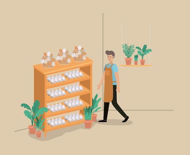 Man met planten vivarium in rekken