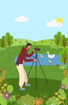 Man met standaard voor camera nemen foto van de natuur