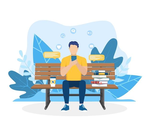 Man met telefoon zit in de natuur