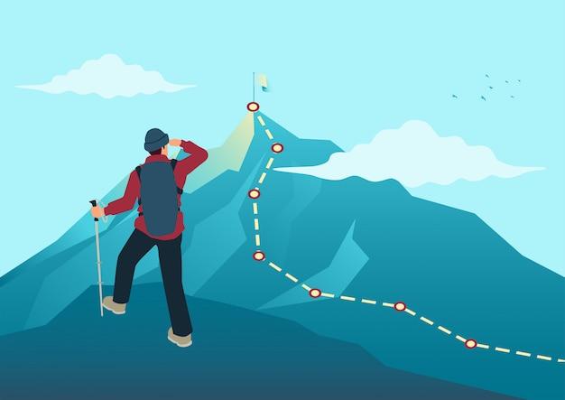 Man op de top van de rots op zoek naar de top van een berg